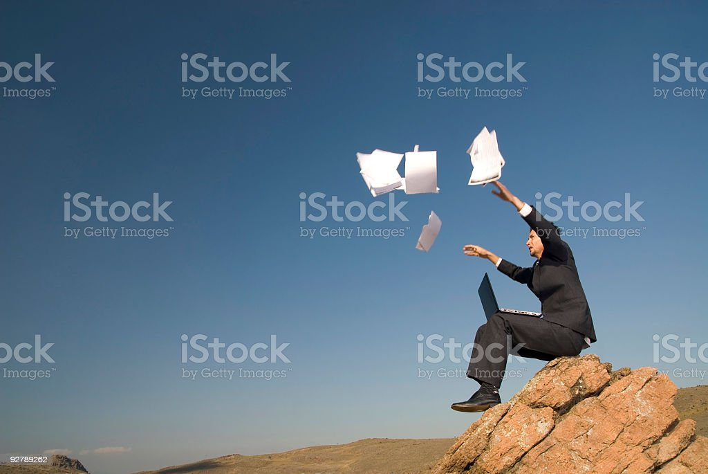 Businessman throwing papers royalty-free stock photo