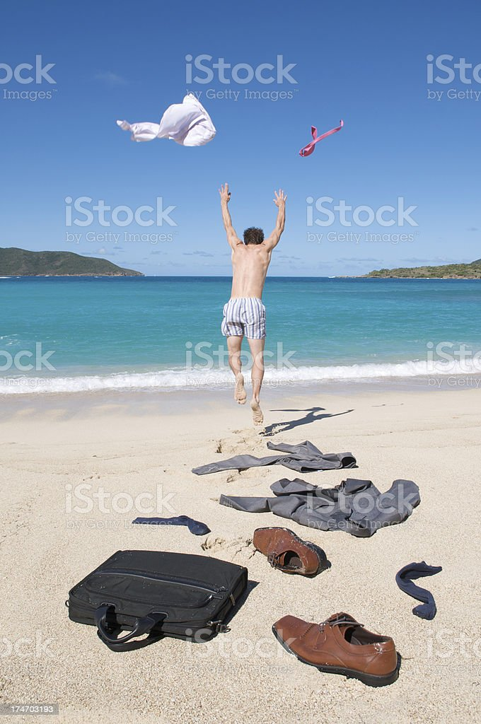 Businessman Throws Off His Suit and Runs to the Sea royalty-free stock photo