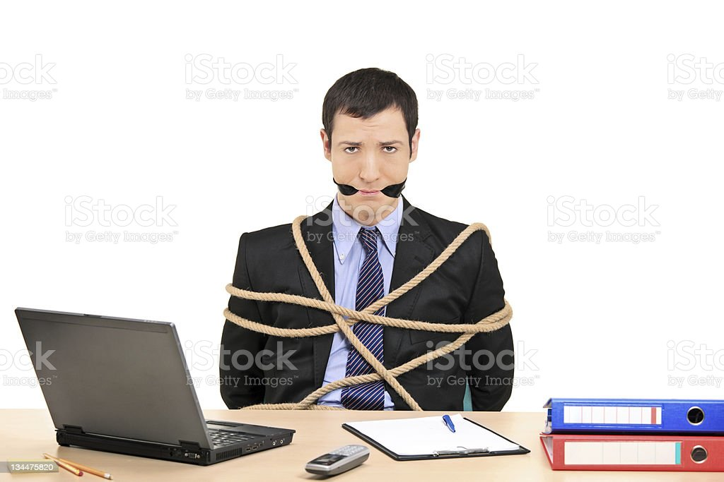 Businessman tied up with rope royalty-free stock photo