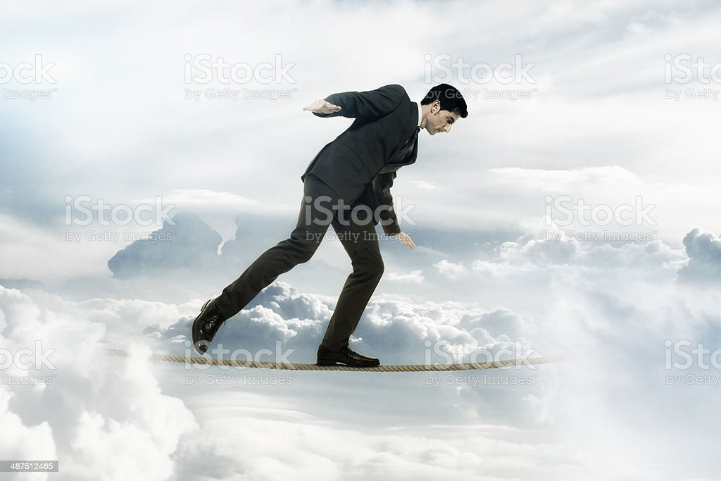 Businessman tightrope walker stock photo