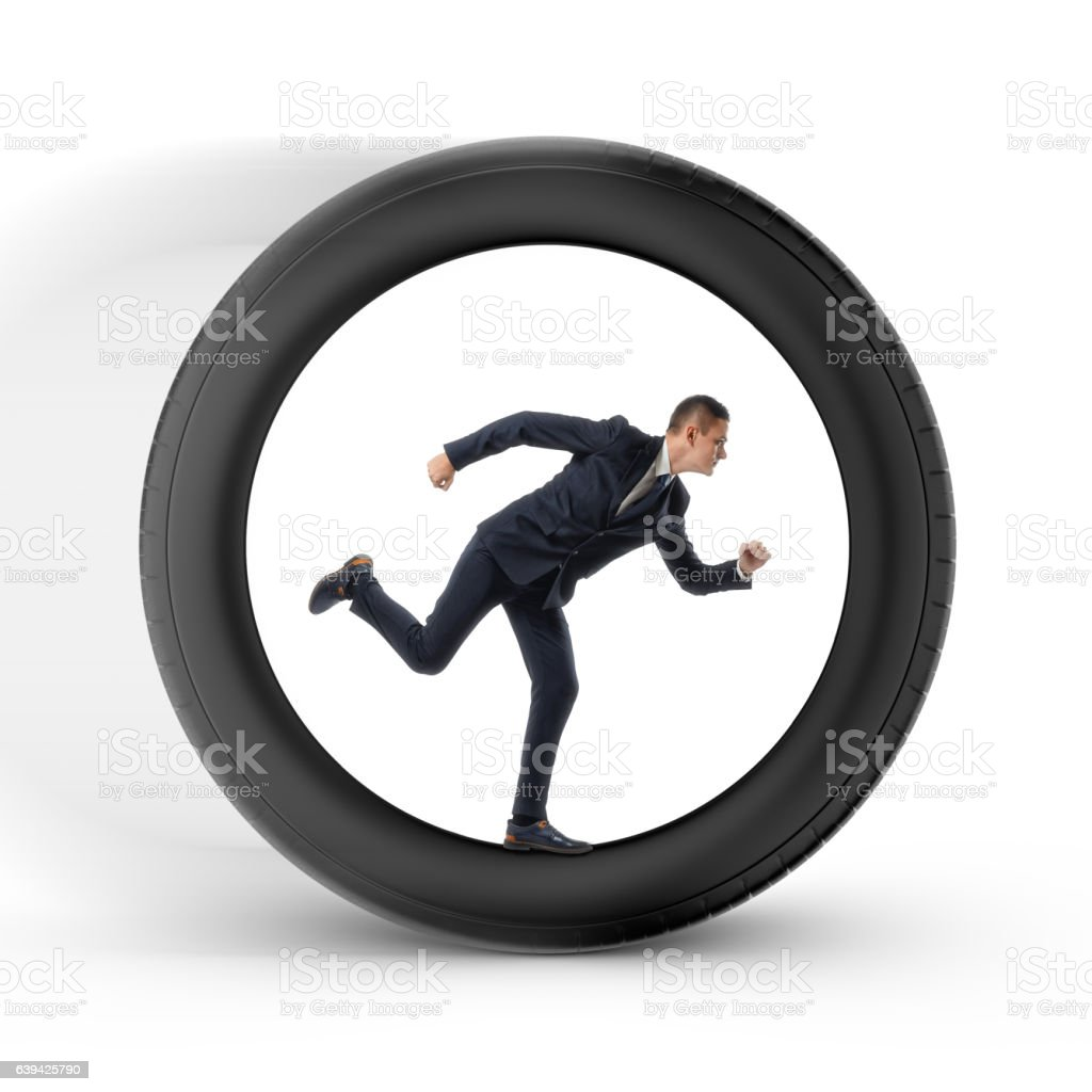 Businessman to be pressed for time is running in the stock photo