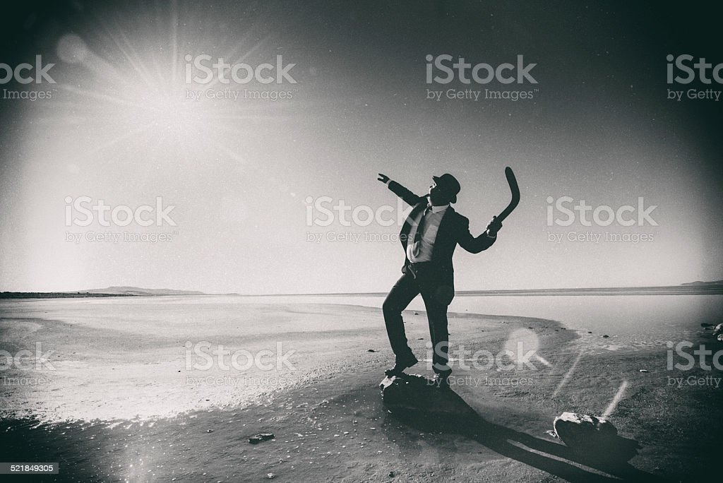 Businessman Tossing a Boomerang to the Sun stock photo