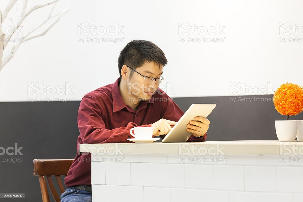 Businessman touch digital tablet in coffee bar stock photo
