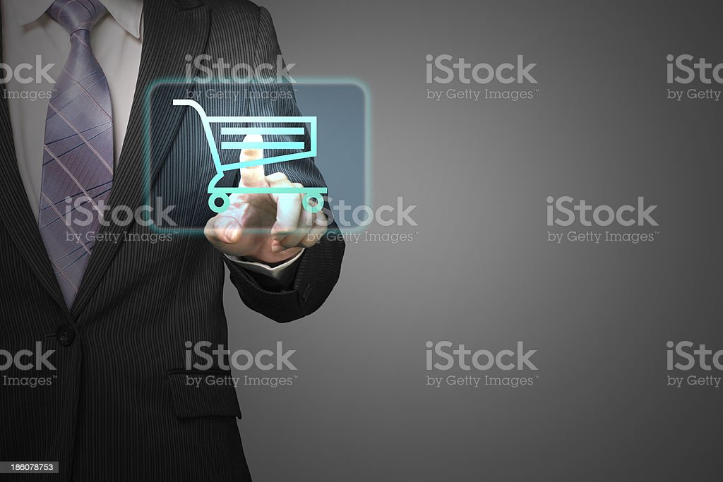 Businessman touch shopping cart icon in gray background royalty-free stock photo