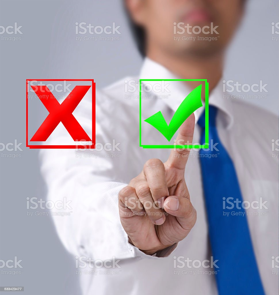 businessman touches of the button wrong in front stock photo