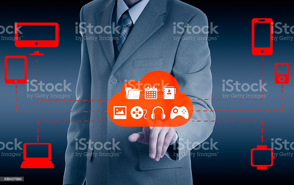 Businessman touching a cloud connected stock photo