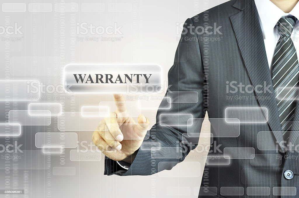 A businessman touching a warranty sign royalty-free stock photo