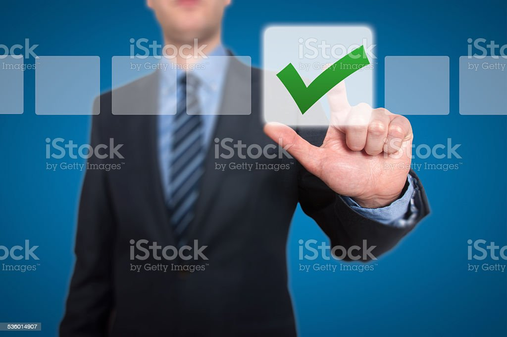 Businessman Touching Button and Ticking Check Box stock photo