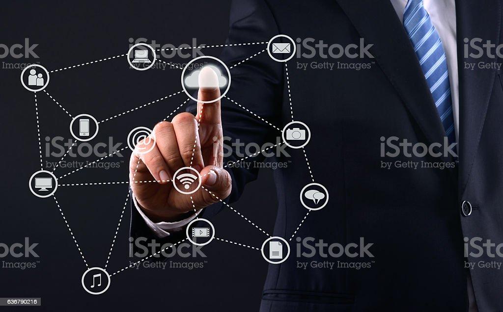 Businessman touching cloud computing diagram stock photo
