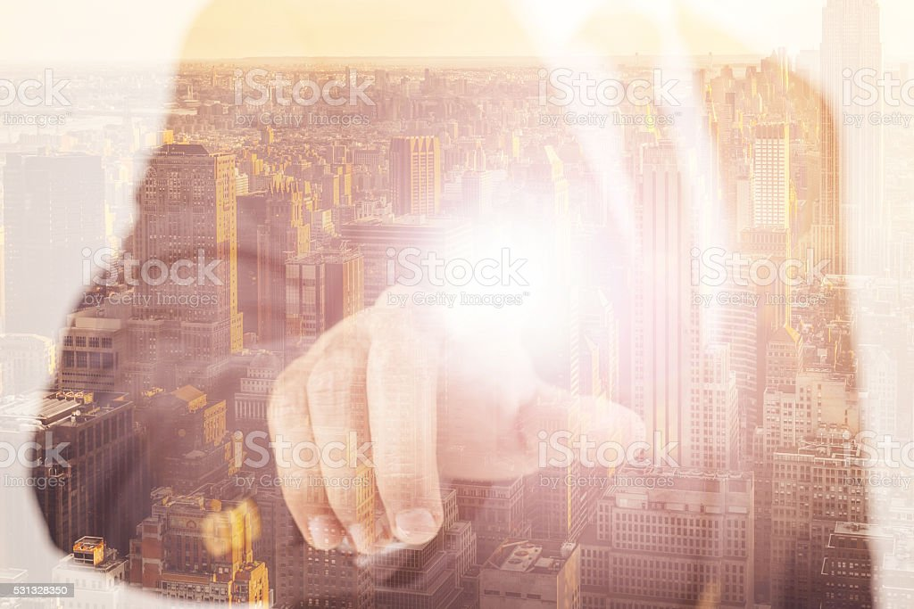 Businessman touching consepts in the city stock photo
