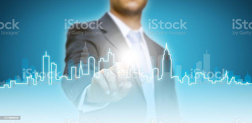 Businessman touching digital city royalty-free stock photo