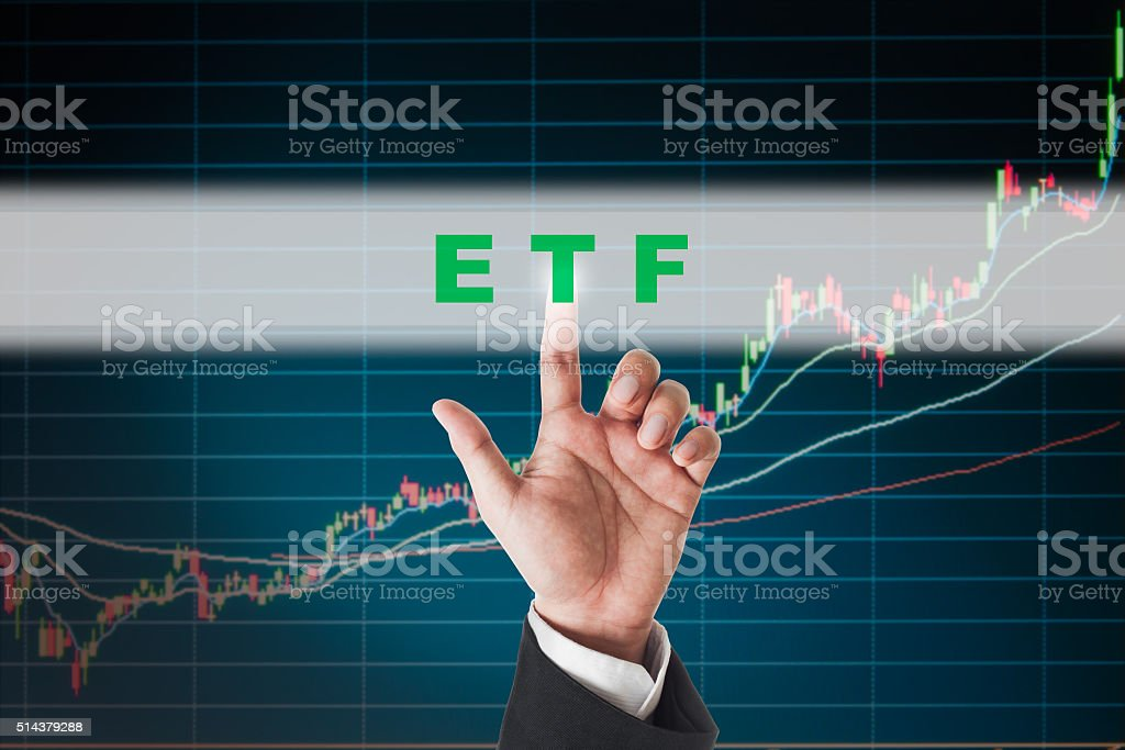 businessman touching ETF  text on  touch screen interface stock photo