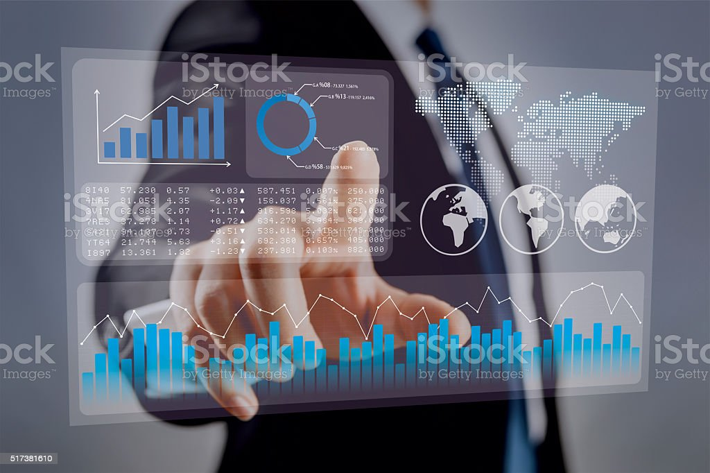 Businessman touching financial dashboard stock photo