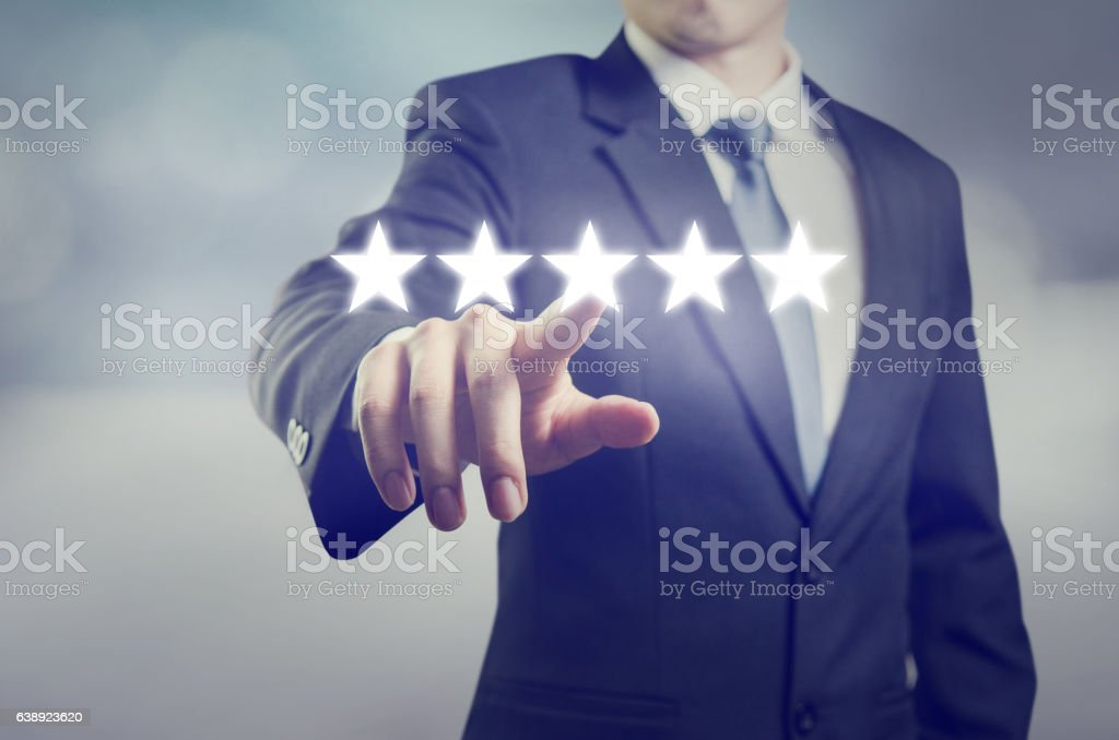 Businessman touching five stars stock photo