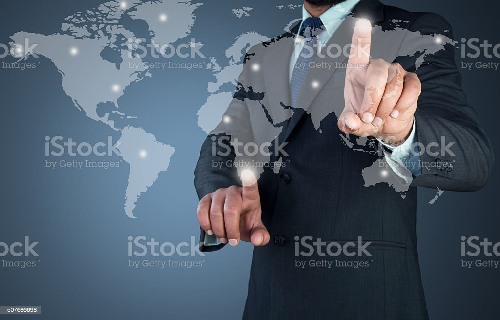 Businessman touching global map on touch screen stock photo