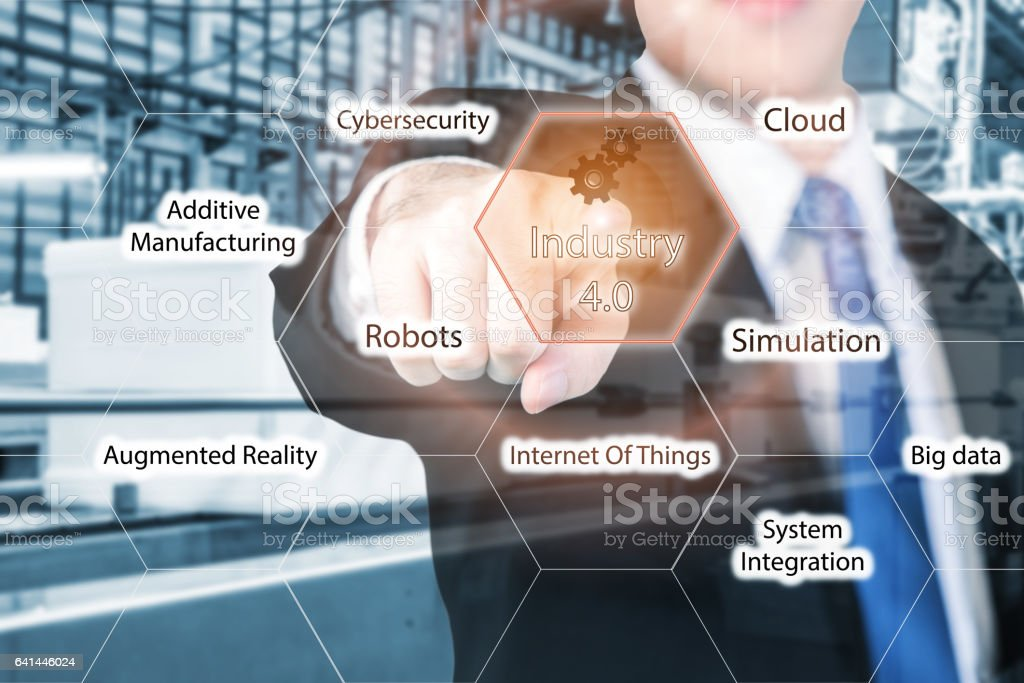 Businessman touching industry 4.0 in virtual interface screen. stock photo