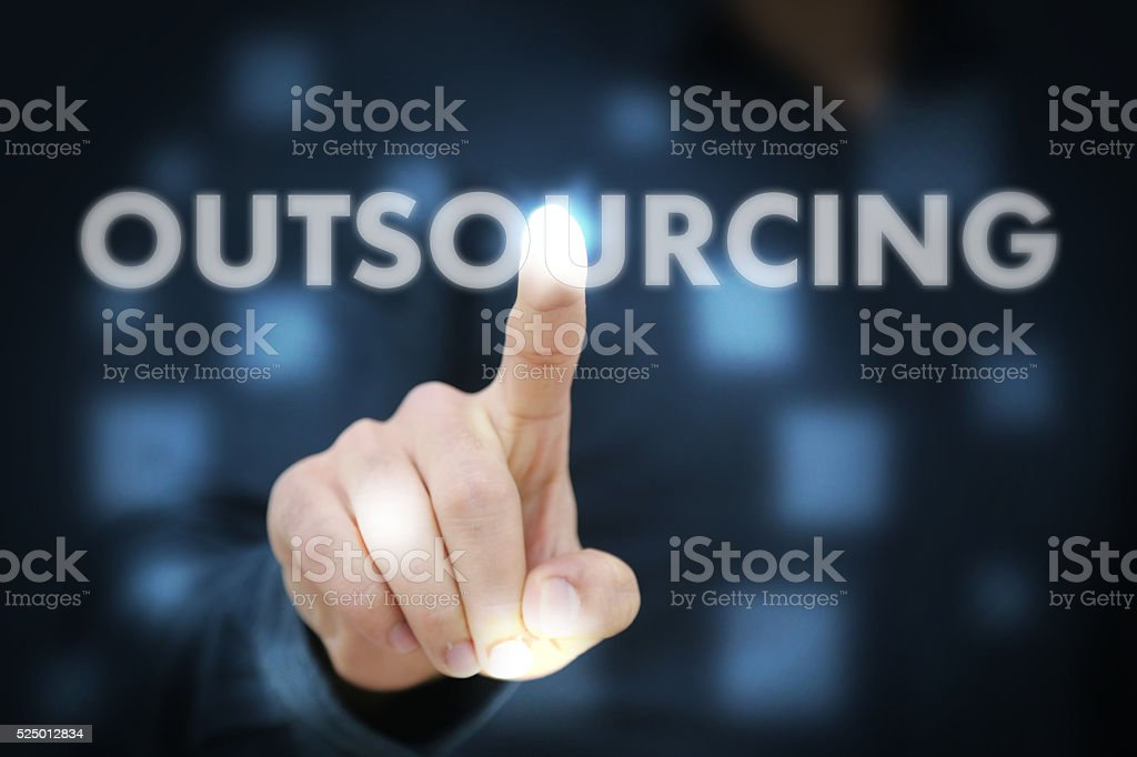 Businessman touching Outsourcing stock photo