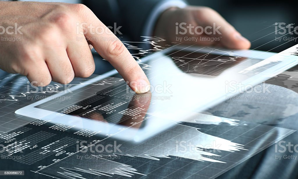 businessman touching screen of tablet computer stock photo
