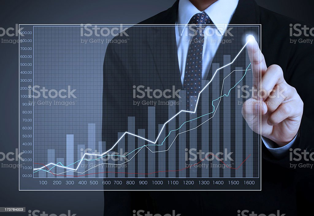 Businessman touching screen with bar graph stock photo