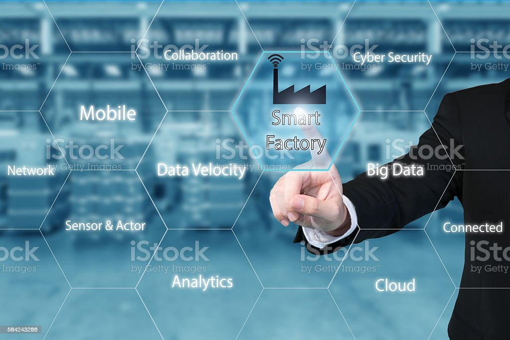 Businessman touching smart factory icon showing data of smart factory. stock photo