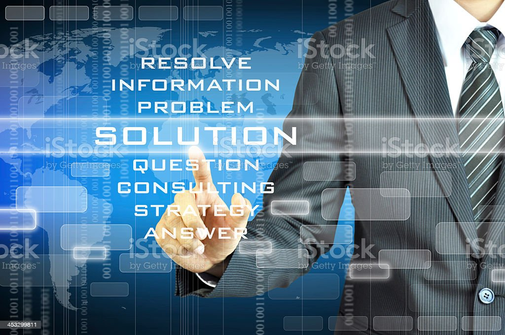 Businessman touching SOLUTION sign stock photo