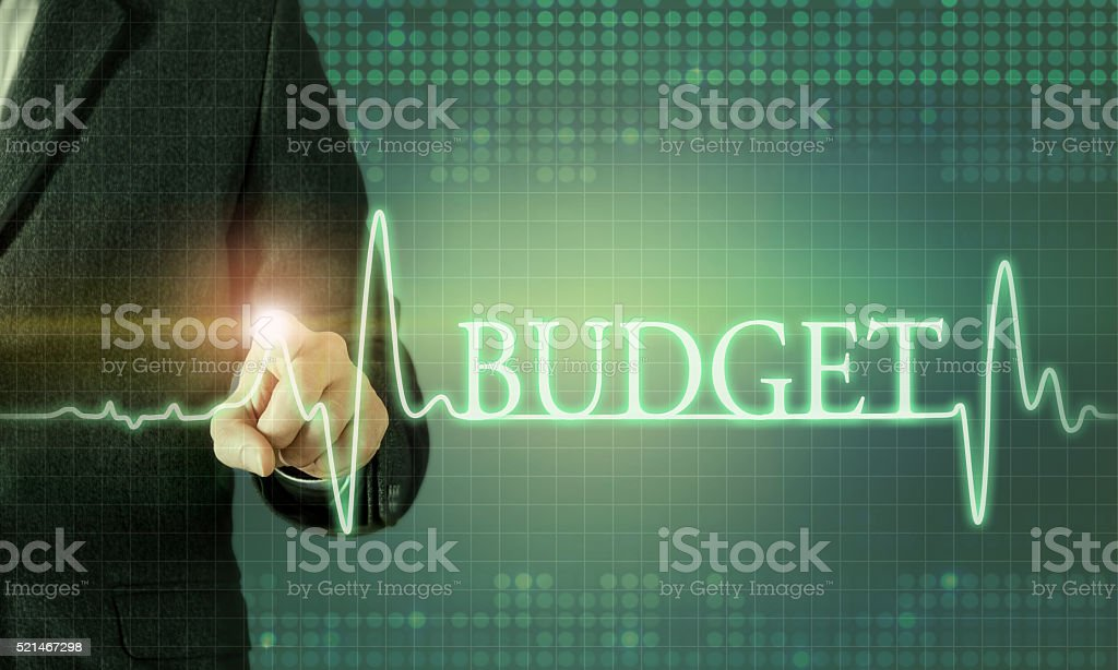 Businessman touching the screen about budget chart stock photo