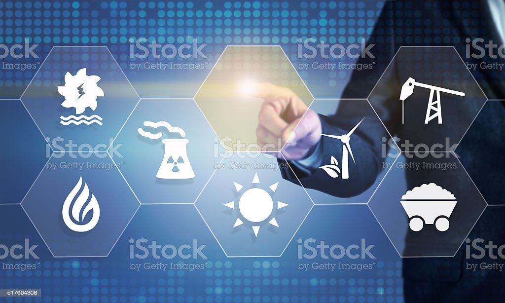 Businessman touching the screen about energy source stock photo