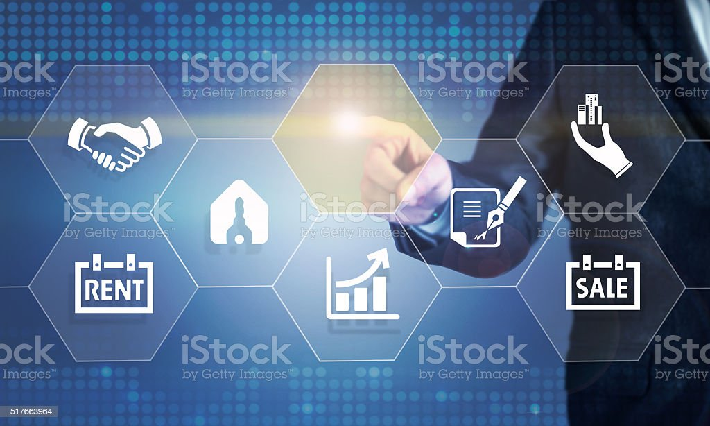 Businessman touching the screen about real estate stock photo