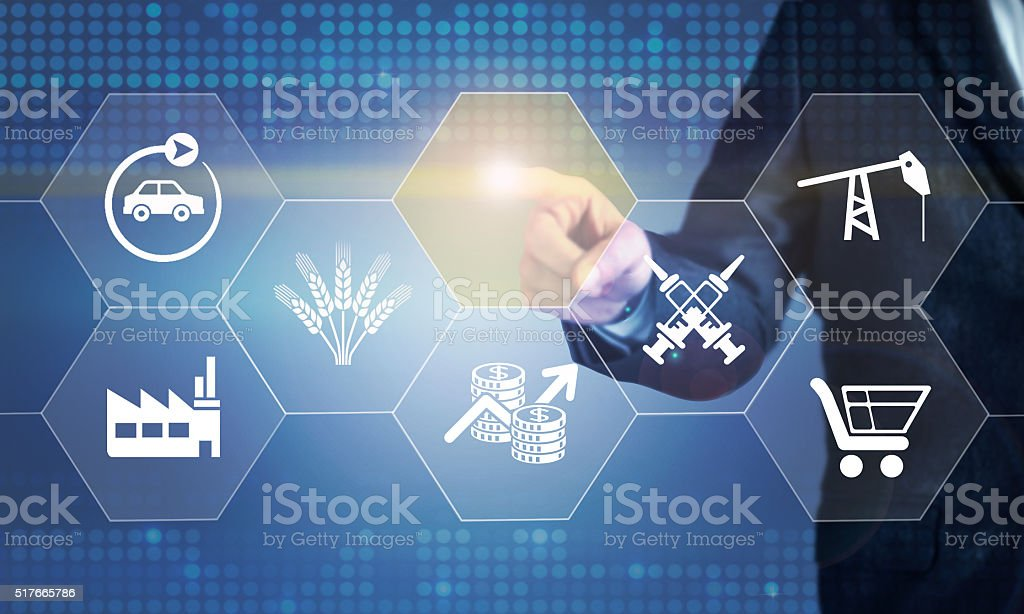 Businessman touching the screen about sectoral consept stock photo