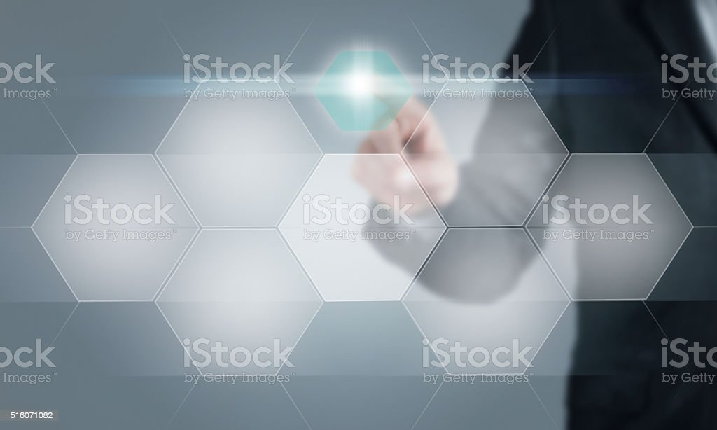 Businessman touching the screen stock photo