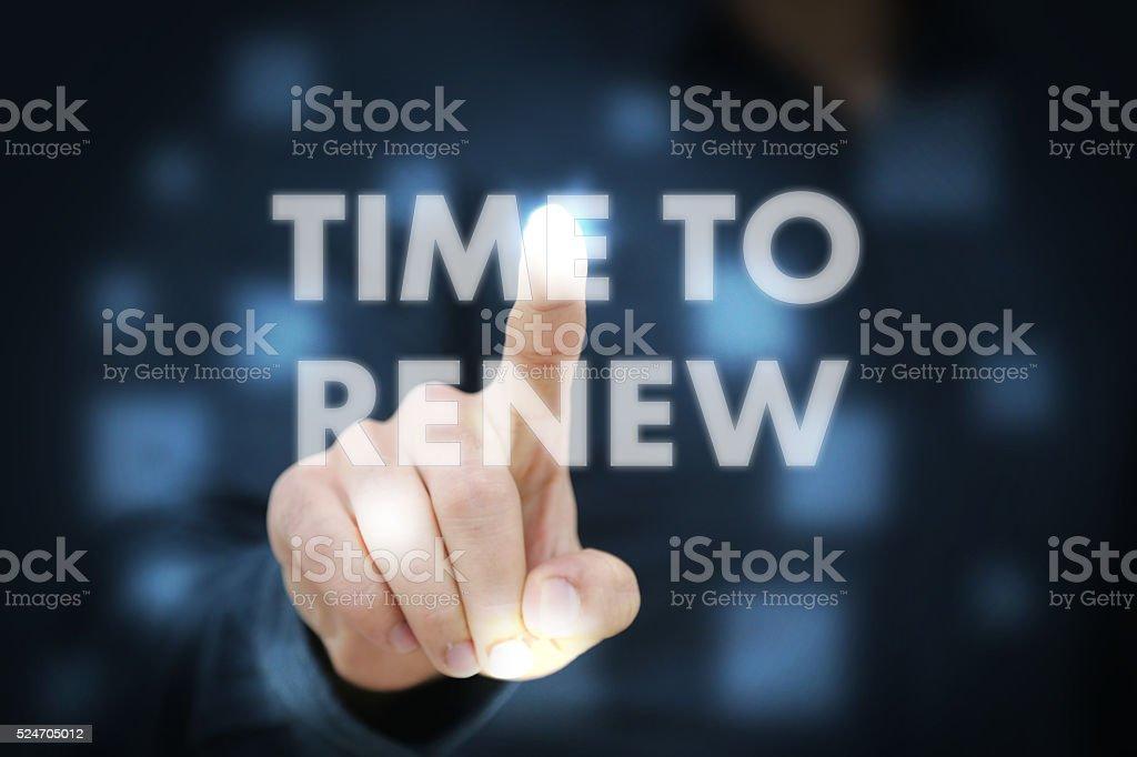Businessman touching Time To Renew stock photo