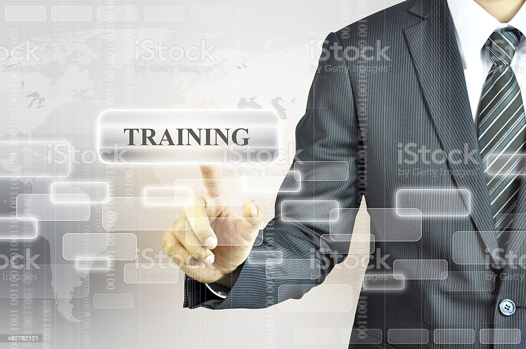 Businessman touching TRAINING sign stock photo