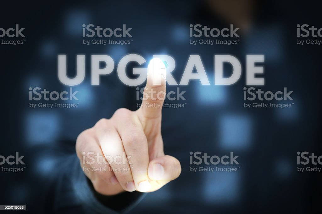 Businessman touching Upgrade stock photo