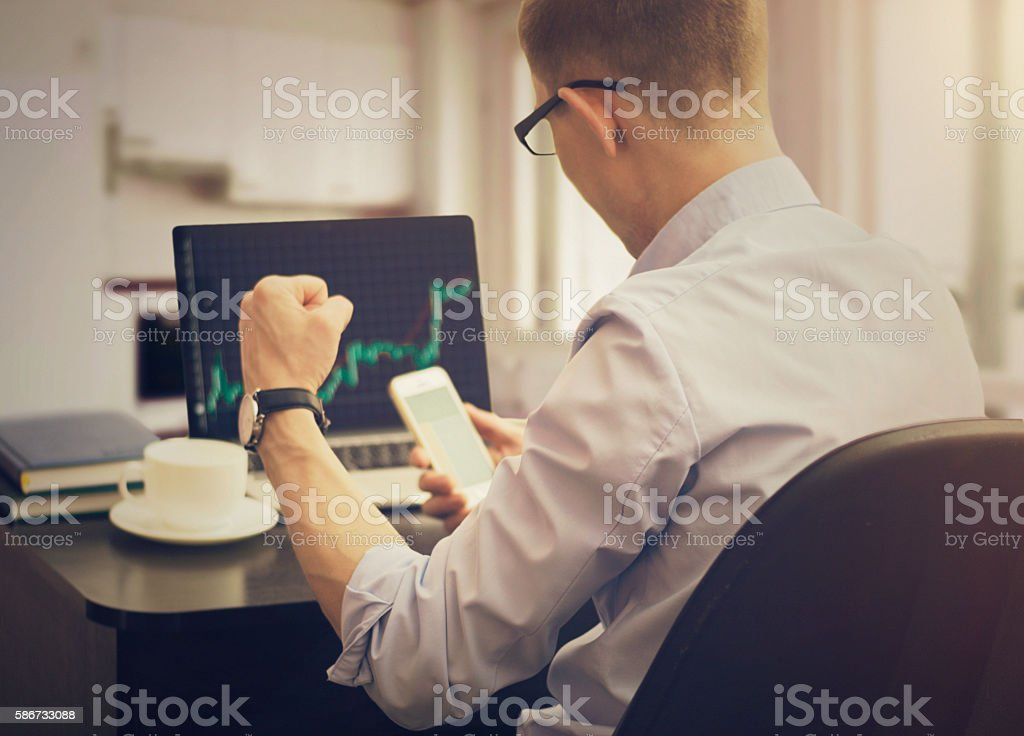 Businessman trader working in the office. stock photo