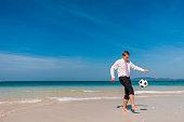 Businessman Travel Beach Football Relaxation Concept