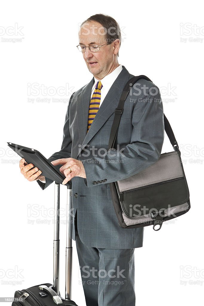Businessman Traveling with Suitcase and Tablet Computer on White Background royalty-free stock photo