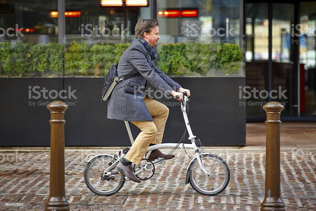 Businessman travelling to office by cycle stock photo