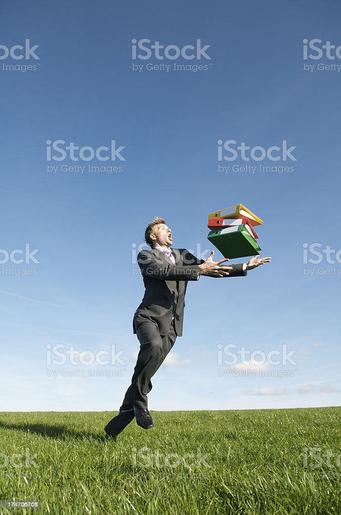 Businessman Trips and Drops Stack of Binders royalty-free stock photo