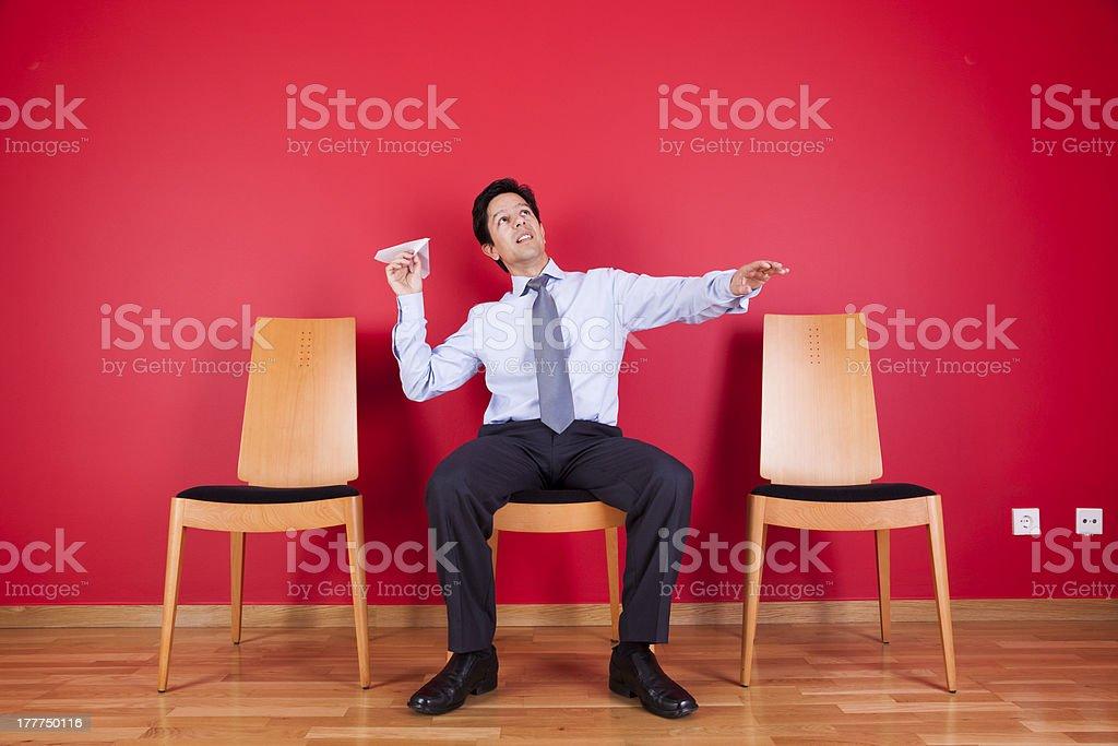 businessman trowing paper planes stock photo