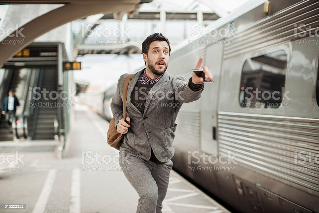 Businessman trying to catch the train stock photo