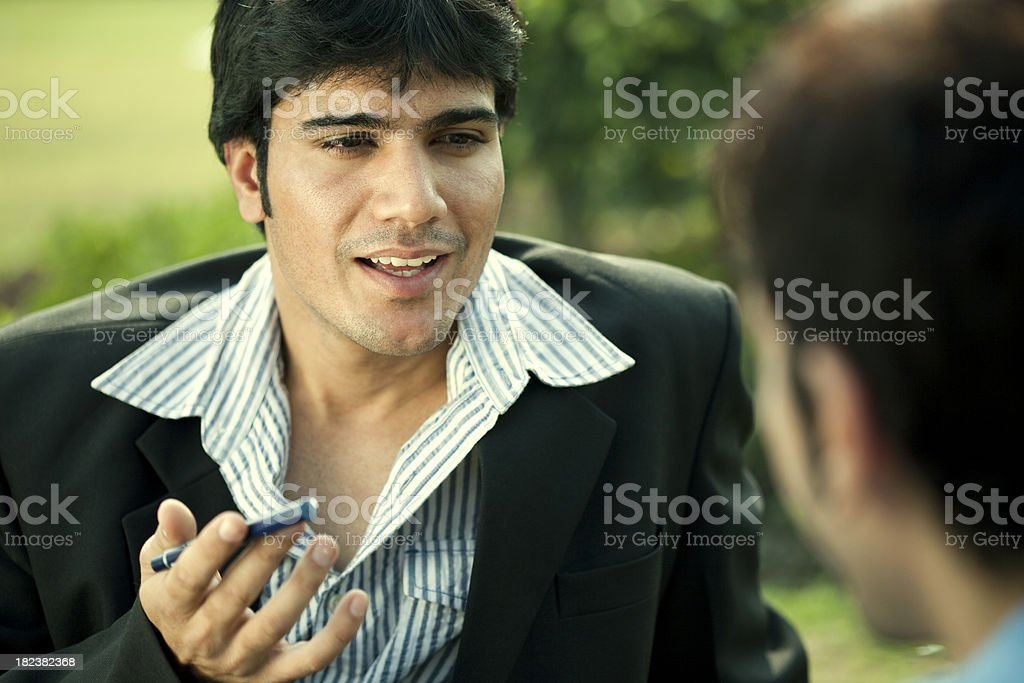 Businessman trying to convince a casual man royalty-free stock photo