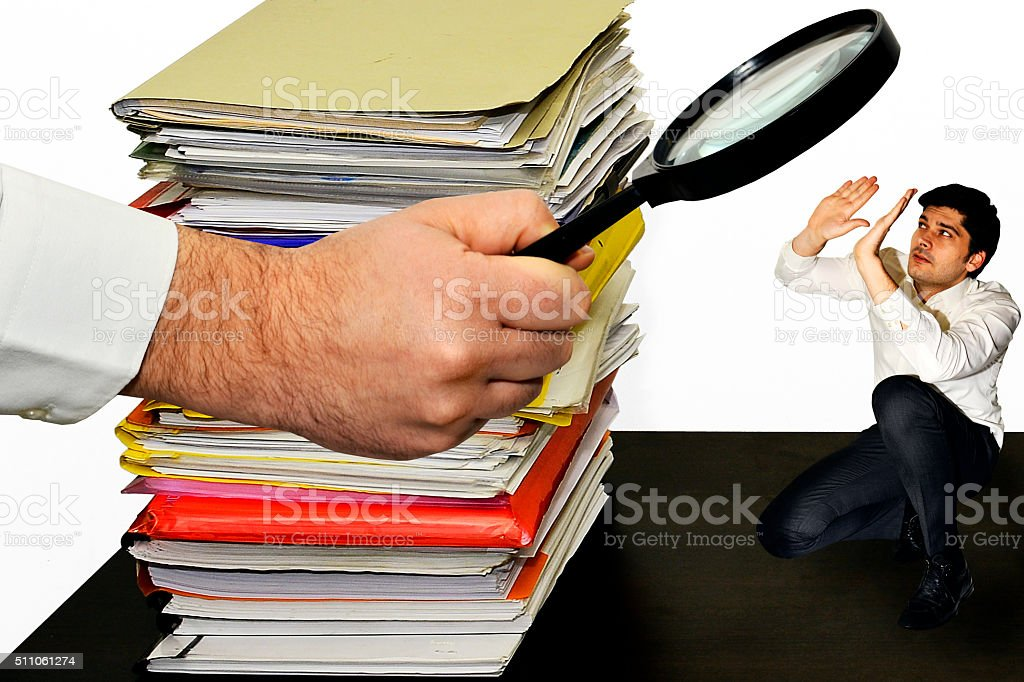 Businessman trying to hide from work stock photo