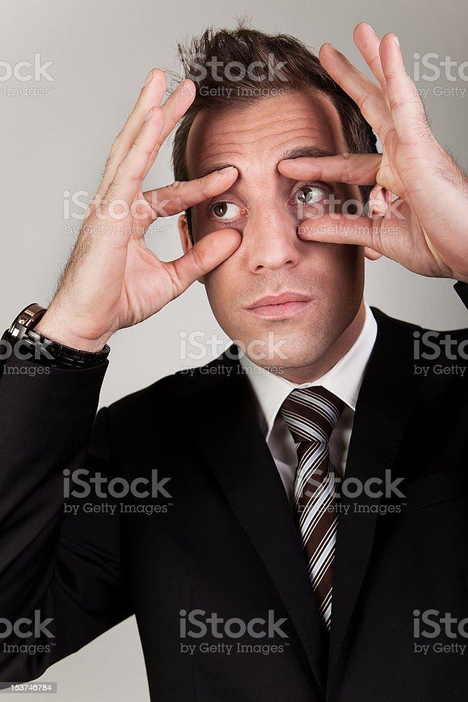 Businessman trying to stay awake stock photo
