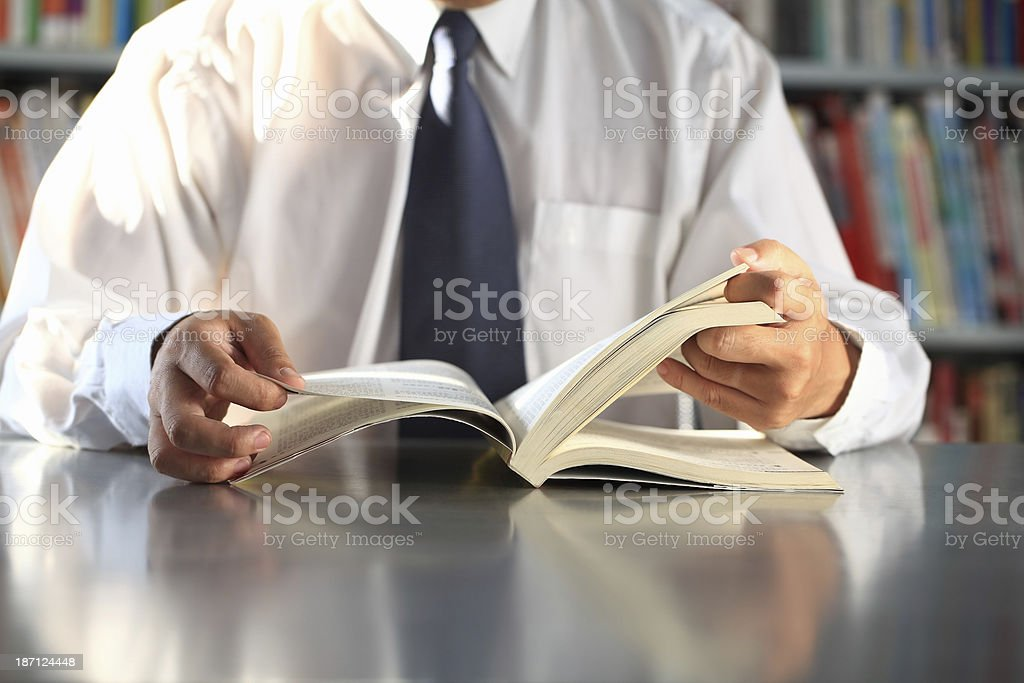Businessman Turning Pages of a Book royalty-free stock photo