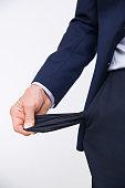Businessman turning pocket inside out