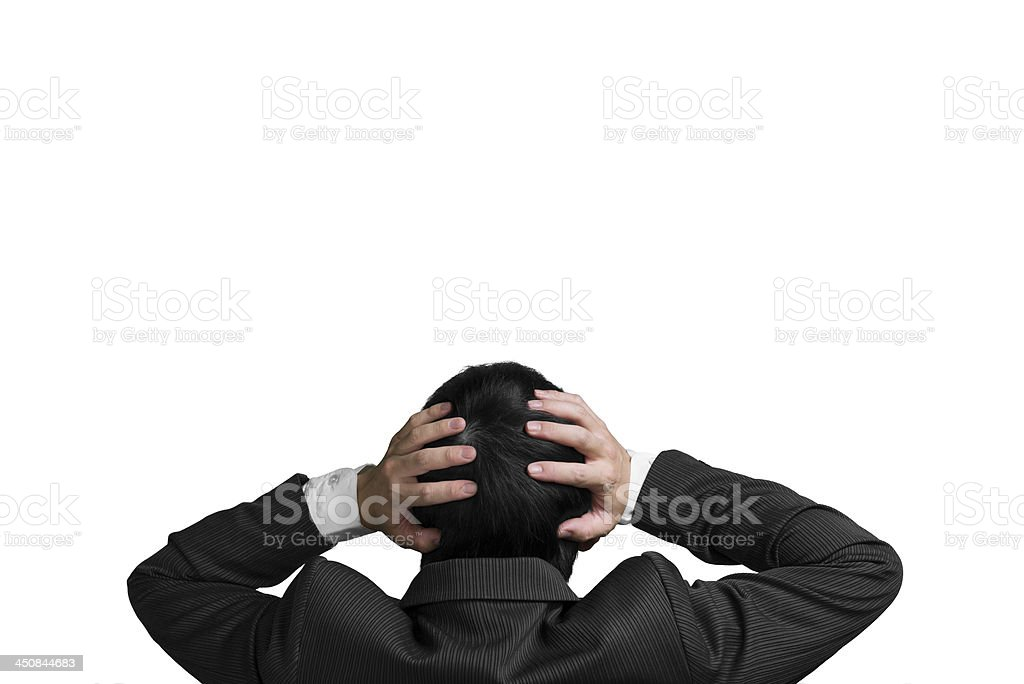 Businessman two hands hold head with chagrin expression isolated stock photo