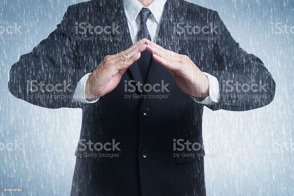Businessman two hands in position to protect stock photo