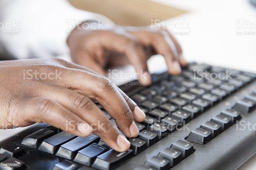 Businessman typing on a black keyboard stock photo