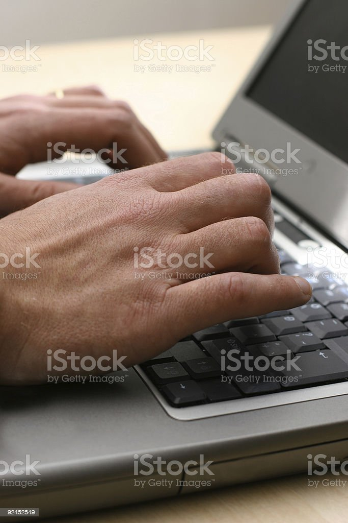 Businessman typing on a laptop royalty-free stock photo