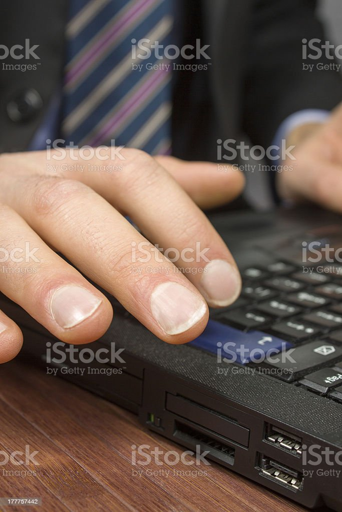 Businessman typing on a Personal Computer keyboard royalty-free stock photo